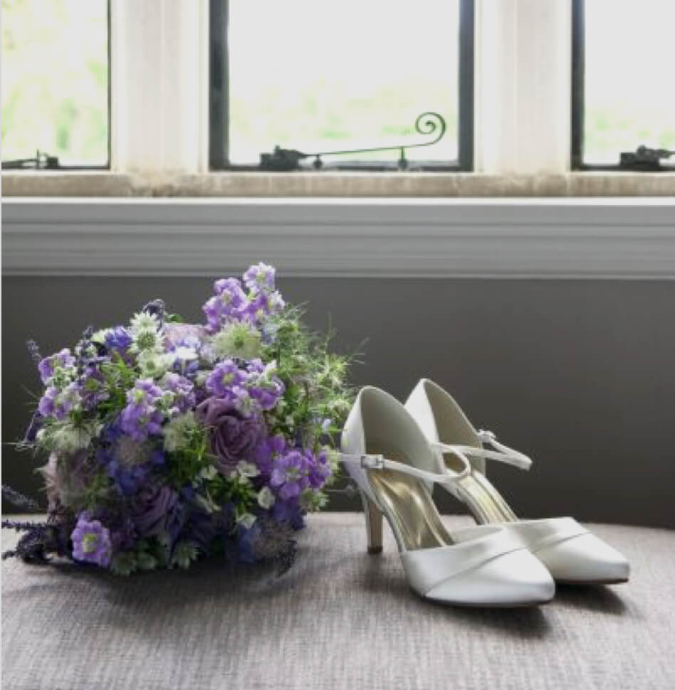 Photo of white bridal shoes
